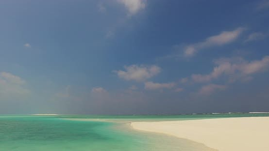 Thumbnail for Daytime flying travel shot of a white sandy paradise beach and blue ocean background in best quality