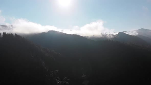 Thumbnail for Aerial View of Dawn Over the Mountains. Fog and Clouds Hovered Mountain Tops