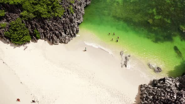 Thumbnail for Tourists Relax on the Beach. Caramoan Islands, Camarines Sur, Matukad, Philippines. Tropical Island