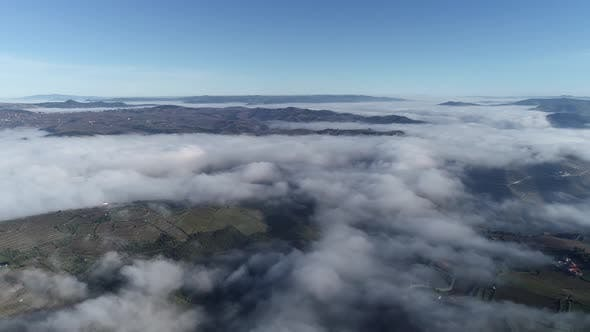 Aerial View From Above of White Puffy Clouds.