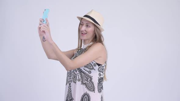 Thumbnail for Portrait of Happy Blonde Tourist Woman Taking Selfie