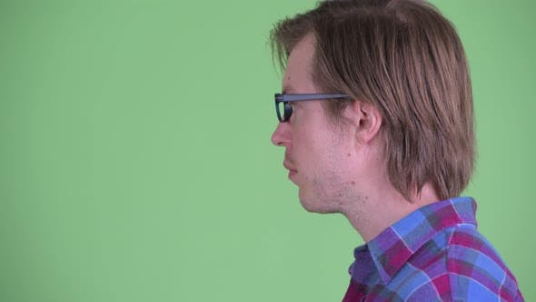 Thumbnail for Closeup Profile View of Young Handsome Hipster Man with Eyeglasses