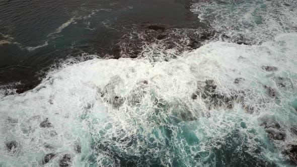 Thumbnail for Bird's Eye View of Waves Crashing on a Rocky Coast