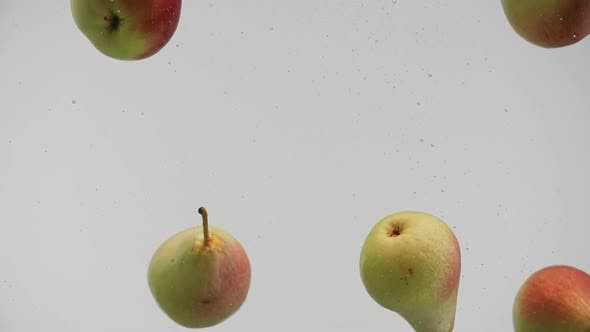 Thumbnail for Fruits Red and Yellow Pears Apples Falling Into Water with Splash and Air Bubbles White Background