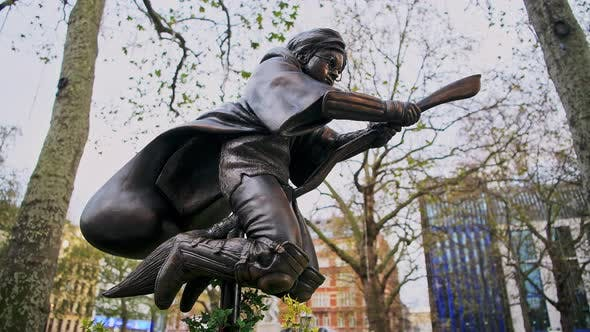 Harry Potter Statue at Leicester Square in London in a popular tourist attraction area in England, E