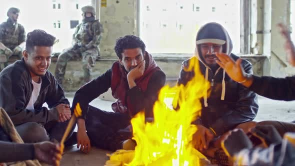 Thumbnail for Arab Refugees Warming by Fire in Destroyed Building