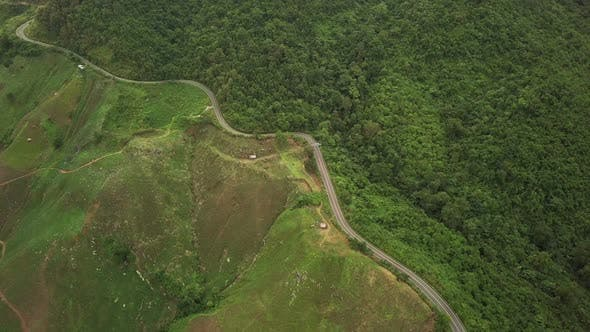 Thumbnail for Aerial View of Countryside Road passing through the Mountain Landscape