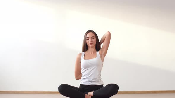 Young Adult Female Doing Yoga at Home.