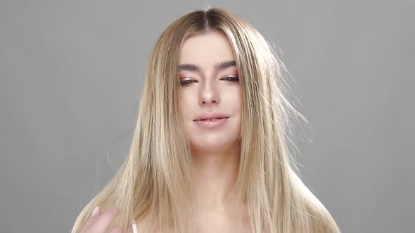 Thumbnail for Cute Girl Touching Her Luxury Blonde Hair