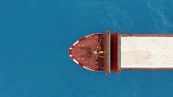 Thumbnail for Aerial View. Red Deck Cargo Ship Sailing on Open Sea