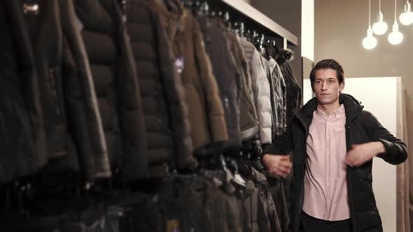 Stylish Man Trying on a Jacket