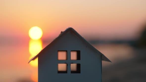 Thumbnail for House Model Against the Sunset