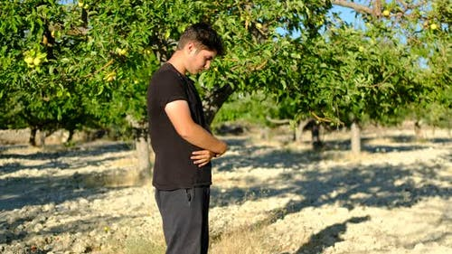 Young Man Praying Outdoors