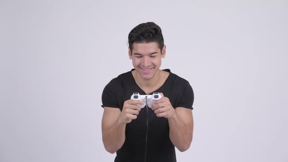 Thumbnail for Young Happy Multi-ethnic Man Playing Games and Winning