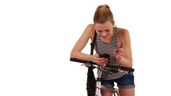 Thumbnail for Girl on bike texting on phone messaging app on white background with copy space