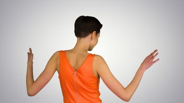 Thumbnail for Girl Dancing in Orange SunDress on gradient background