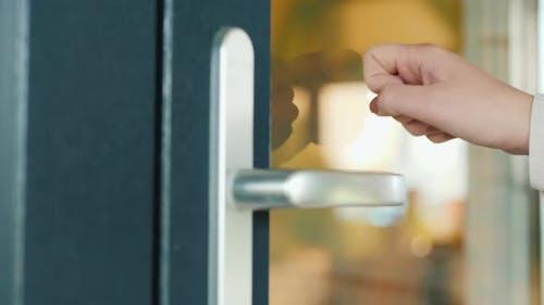 Hand Knocks on the Front Door