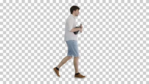 Thumbnail for Young man playing ukulele while walking, Alpha Channel