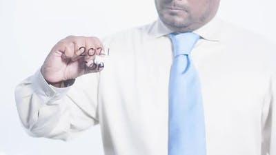 Asian Businessman Writes 2021 Goals