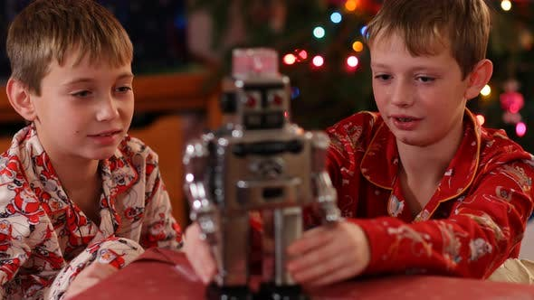 Thumbnail for Boys playing with classic toy robot on Christmas