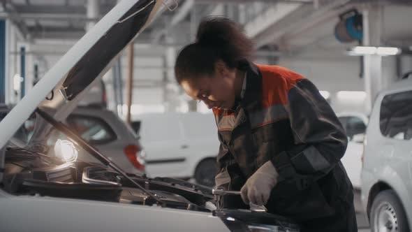 Thumbnail for Female Auto Mechanic Fixing Car