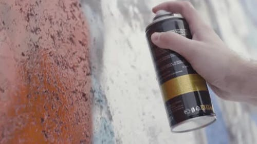 Hand Holding A Spray Paint