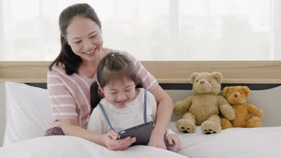 Mother and daughter watching tablet (3)
