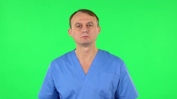 Thumbnail for Medical Man Listens Attentively and Nods His Head Pointing Finger at Viewer. Green Screen