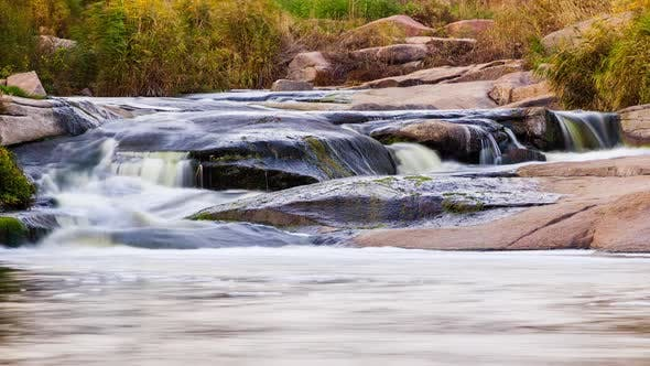 Wild Mountain River Flowing with Stone Boulders and Stone Rapids