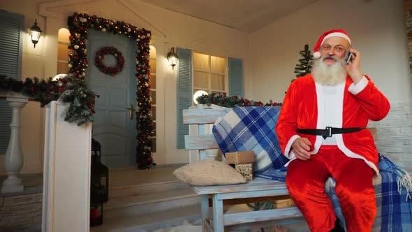Thumbnail for Joyous Santa Claus Speaking By Phone.