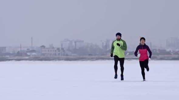 Thumbnail for Couple Preparing for Winter Marathon