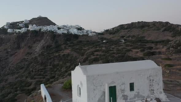 Thumbnail for Flight Over Small Town Church on Greek Island Milos at Dusk