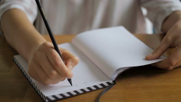 Thumbnail for Personen-Handschriftideen auf Notizbuch