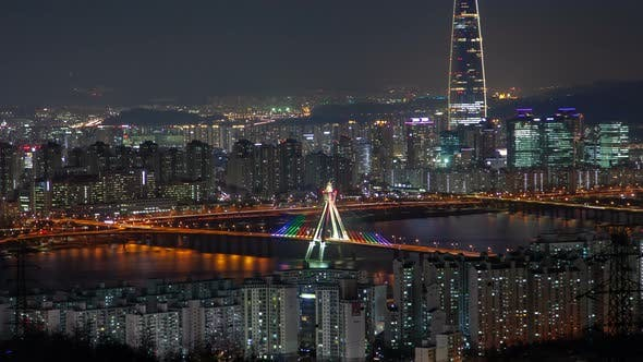 Thumbnail for Timelapse Seoul Skyscraper Surrounded By Buildings