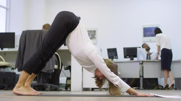 Thumbnail for Businesswoman Doing Yoga at Workplace