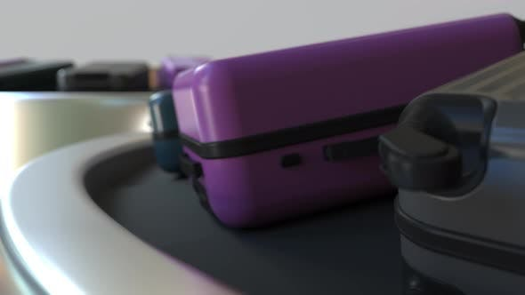 Thumbnail for Suitcases on a Moving Baggage Carousel