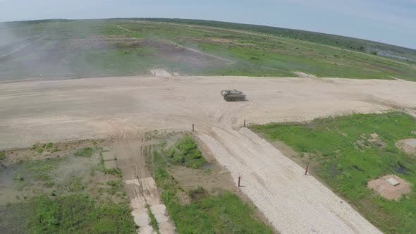 Aerial shot of military vehicles on shooting-ground