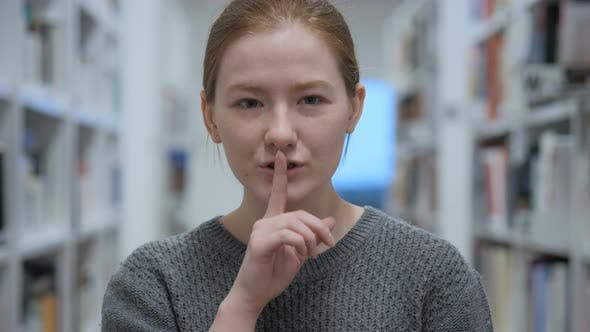 Thumbnail for Young Woman Gesturing  Silence, Finger on Lips, Indoor