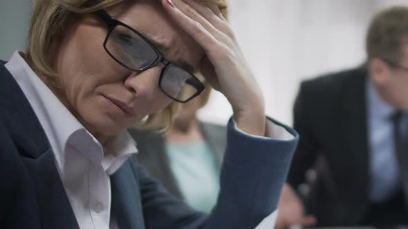 Thumbnail for Female Office Worker Upset At Conference, Feels Headache, Boss Angry About Fail
