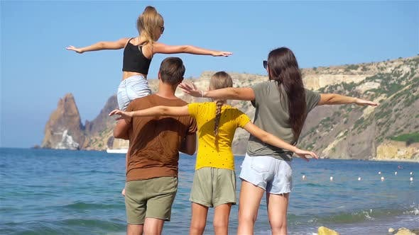 Cover Image for Young Family on Vacation Have a Lot of Fun