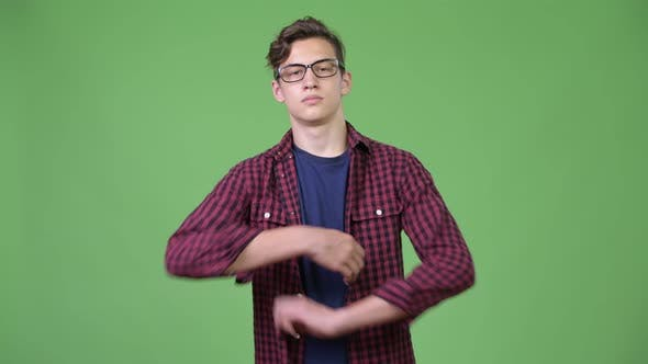 Cover Image for Young Handsome Teenage Nerd Boy with Arms Crossed