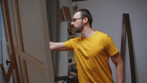 Thumbnail for Guy Painting on Large Canvas