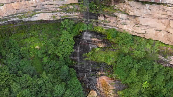 Blue Mountains National Park. Waterfall in the Middle of a Cliff, Around Green Trees