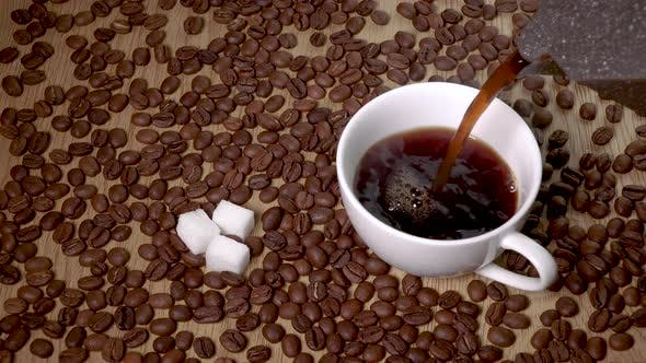 Thumbnail for Hot Coffee Is Poured Into a Cup From a Coffee Pot