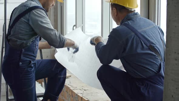 Thumbnail for Construction Engineer and Builder Discussing Work