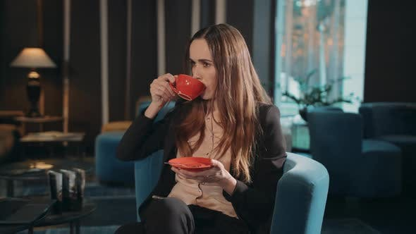 Thumbnail for Business Woman Drinking Tea in Hotel Lobby. Businesswoman Drinking Coffee
