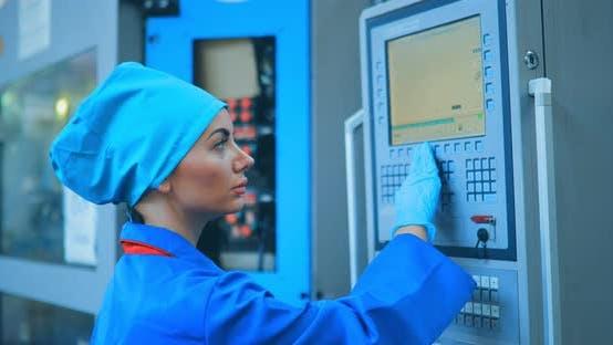 Woman Engineer Adjusts the Conveyor Machine
