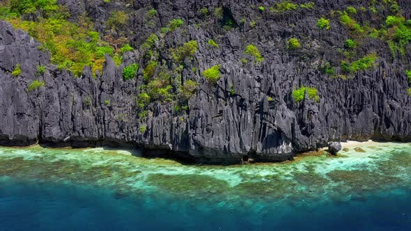 Thumbnail for Clear Waters and Jagged Limestone Cliffs of Matinloc Island at Palawan, Philippines
