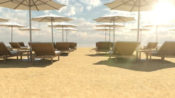 Empty Wooden Deck Chairs and Umbrellas on Beach