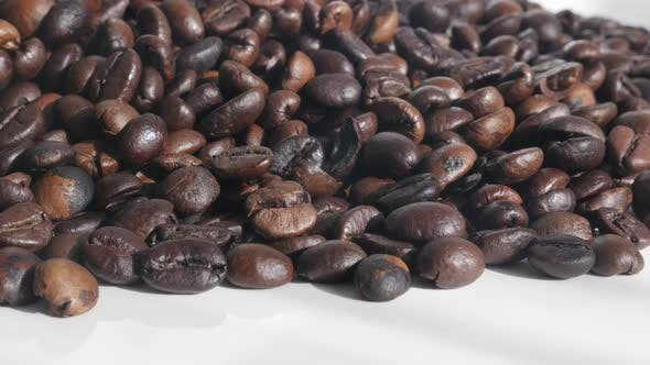 Thumbnail for Tilting over Arabica coffee beans 4K footage